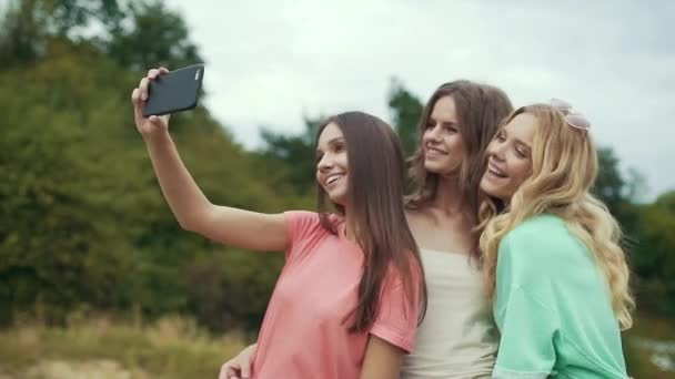 Beautiful Girls Friends Taking Photos On Mobile Phone, Having Fun And Laughing In Nature.