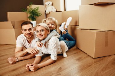 Smiling People With Kid Moving In New House, Hugging While Sitting Near Boxes. High Resolution. stock vector