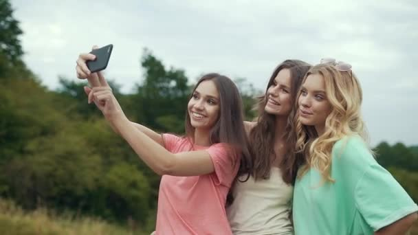 Beautiful Girls Taking Photos On Phone In Nature.