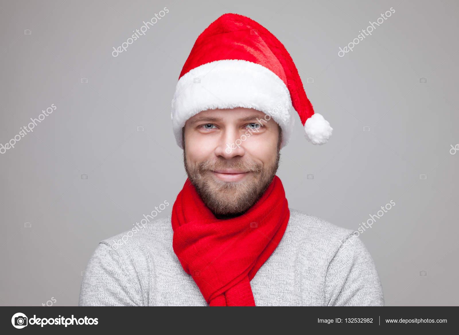 Kerstmuts Met Licht : Knappe man met baard dragen een kerstmuts u stockfoto