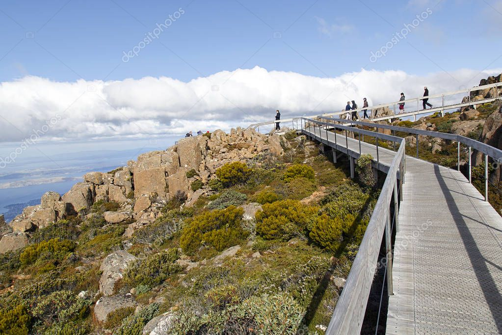Hobart, Tasmania, Australia: March 28, 2018: Tourists enjoy the views of Hobart from the Pinnacle observation point and shelter on the summit of Mount Wellington.
