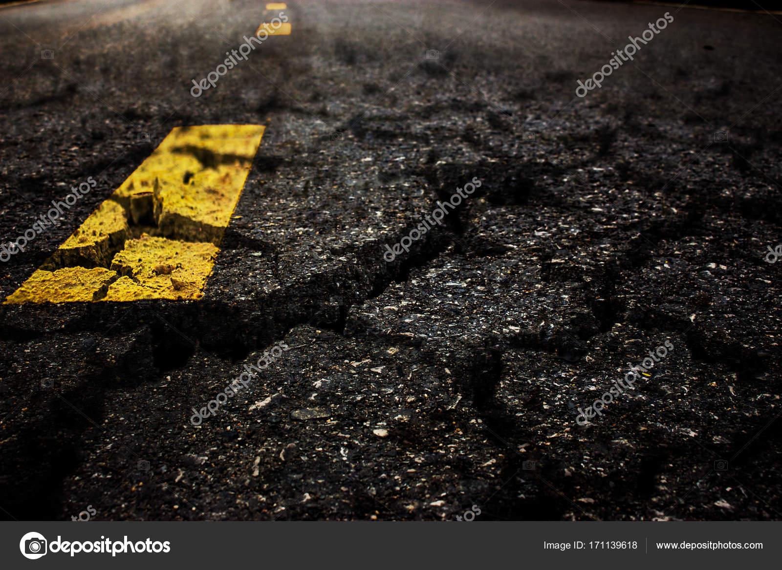 crack textured asphalt road background � stock photo