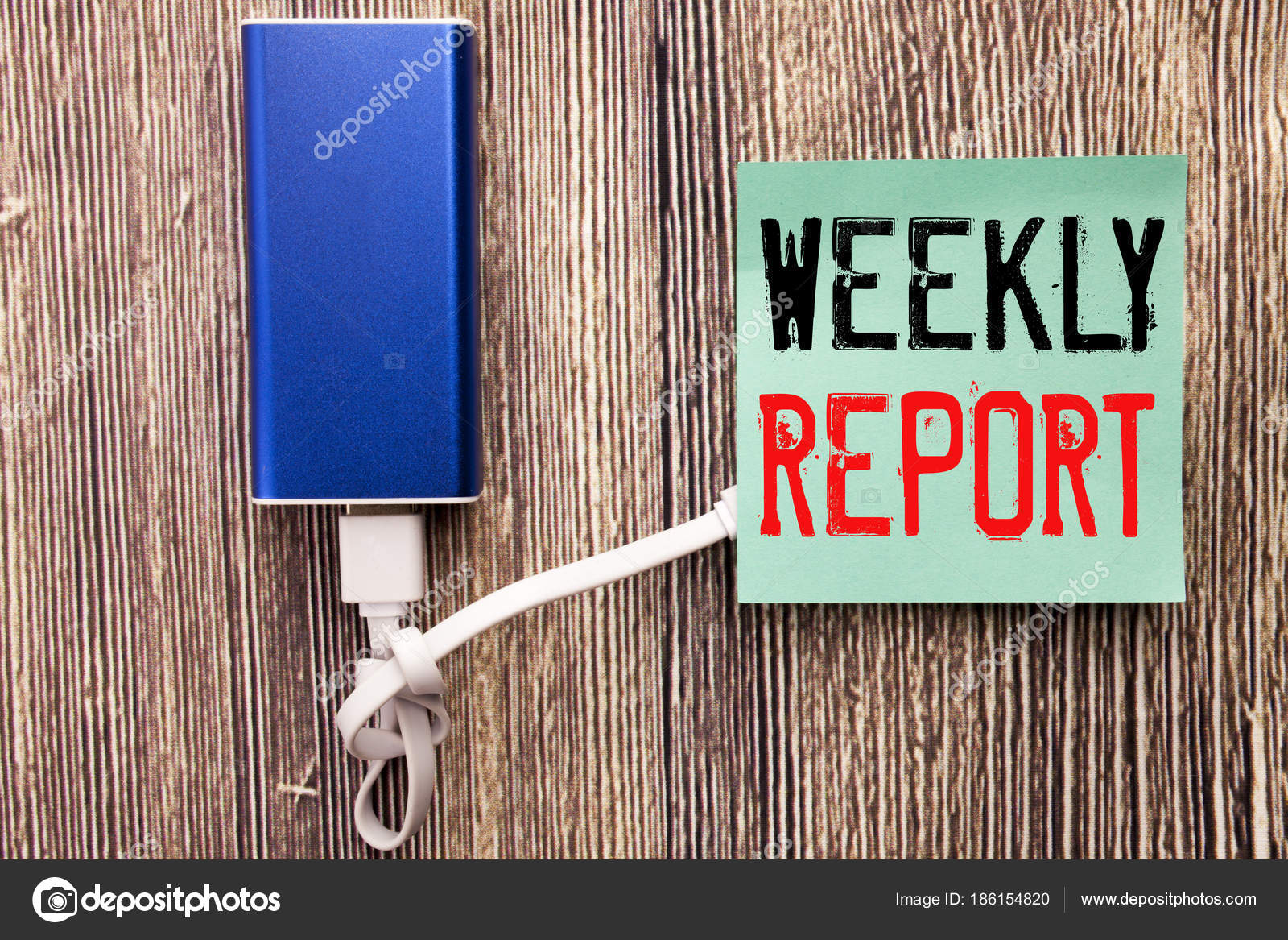 Handwritten text caption showing Weekly Report. Business concept ...