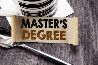 Handwriting Announcement text showing Master s Degree. Business concept for Academic Education written on sticky note paper on the wooden wood background. With marker and coffee. Office top view.