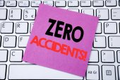 Handwriting Announcement text showing Zero Accidents. Business concept for Safety At Work Hazard written on sticky note paper on the white keyboard background.