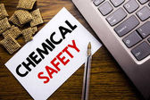 Handwriting Announcement text showing Chemical Safety. Business concept for Hazard Health At Work written on sticky note paper on the wooden background next to the laptop keyboard
