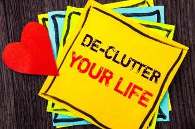 Writing text showing  De-Clutter Your Life. Concept meaning Free Less Chaos Fresh Clean Routine written on Stikcy Note Paper on the wood background Love Heart