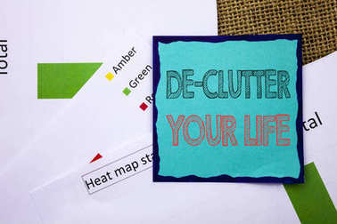 Conceptual writing text showing De-Clutter Your Life. Concept meaning Free Less Chaos Fresh Clean Routine written on Sticky Note Paper on the textured background. Heat Map Status