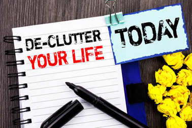 Writing text showing  De-Clutter Your Life. Business photo showcasing Free Less Chaos Fresh Clean Routine written on notebook book paper on the wooden background Today