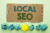Photo Conceptual hand writing showing Local Seo. Business photo text Search Engine Optimization Strategy Optimize Local Find Keywords written on Tear Cardboard on plain background Crumpled Paper Balls.