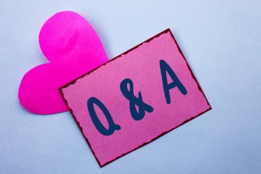 Writing note showing Q A. Business photo showcasing Ask Frequently Faq Asked Question Help Solving Doubt Query Support written on Pink Sticky Note Paper on the Plain background with Heart.