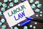 Writing note showing  Labour Law. Business photo showcasing Employment Rules Worker Rights Obligations Legislation Union written on Cardboard Piece on the wooden background Marker next to it.