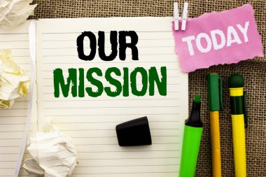 Writing note showing  Our Mission. Business photo showcasing Goal Motivation Target Growth Planning Innovation Vision written on Notebook Book on the jute background Today Pens next to it.