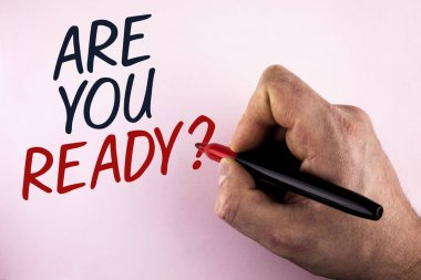Word writing text Are You Ready Question. Business concept for Prepare well to face upcoming business changes written by Man holding Marker in Hand on plain background.