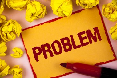 Writing note showing  Problem. Business photo showcasing Trouble that need to be solved Difficult Situation Complication written on Sticky Note paper within Paper Balls on plain background.