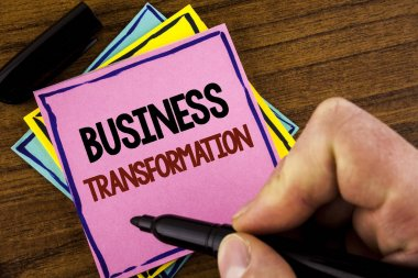 Word writing text Business Transformation. Business concept for Making changes in conduction of the company Upgrade written by Man Pink sticky note paper holding marker wooden background stock vector