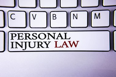 Writing note showing  Personal Injury Law. Business photo showcasing guarantee your rights in case of hazards or risks written on white keyboard key with copy space Top view.
