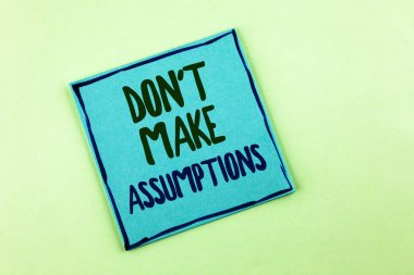 Conceptual hand writing showing Do not Make Assumptions. Business photo showcasing predict events future without clue Alternative Facts written on Sticky Note Paper on the plain background.