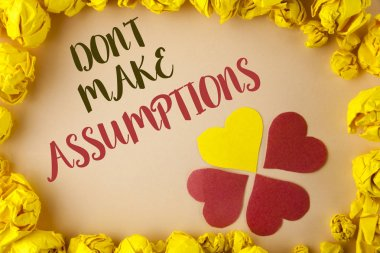 Conceptual hand writing showing Do not Make Assumptions. Business photo showcasing predict events future without clue Alternative Facts written on plain background within Paper Balls Hearts.