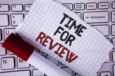 Conceptual hand writing showing Time For Review. Business photo text Giving Feedback Evaluation Rate job test or product Qualify written on Tear Notebook paper placed on the Laptop Marker next to it..