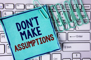 Word writing text Do not Make Assumptions. Business concept for predict events future without clue Alternative Facts written on Sticky Note Paper placed on White Keyboard Paper Pins next to it.