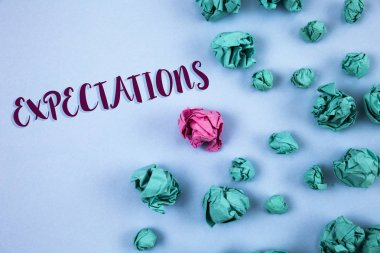 Conceptual hand writing showing Expectations. Business photo text Huge sales in equity market assumptions by an expert analyst written on Plain Blue background Paper Balls next to it.