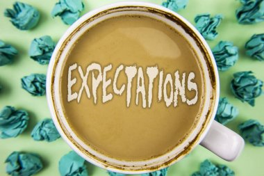 Word writing text Expectations. Business concept for Huge sales in equity market assumptions by an expert analyst written on Tea in white Cup within Crumpled Paper Balls on plain background.