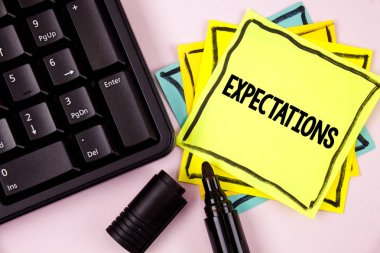 Word writing text Expectations. Business concept for Huge sales in equity market assumptions by an expert analyst written on Sticky Note paper on plain background Marker and Keyboard next to it.