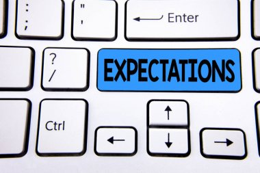 Writing note showing Expectations. Business photo showcasing Huge sales in equity market assumptions by an expert analyst written on Blue Key Button on White Keyboard with copy space. Top view.