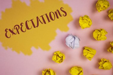 Word writing text Expectations. Business concept for Huge sales in equity market assumptions by an expert analyst written on Painted background Crumpled Paper Balls next to it.