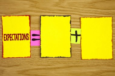 Handwriting text writing Expectations. Concept meaning Huge sales in equity market assumptions by an expert analyst written on Sticky Note Paper on wooden background. Equation with Plus sign.
