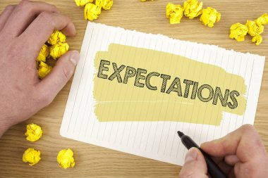 Writing note showing Expectations. Business photo showcasing Huge sales in equity market assumptions by an expert analyst written on Tear Notebook Paper on wooden background Marker Paper Balls.