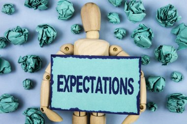 Word writing text Expectations. Business concept for Huge sales in equity market assumptions by an expert analyst written on Sticky note paper within Paper Balls on plain background Jointed Toy