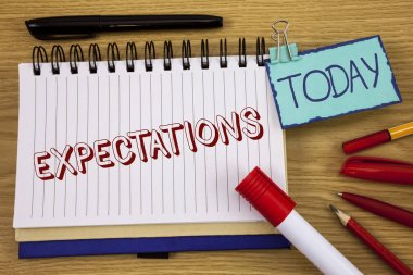 Conceptual hand writing showing Expectations. Business photo text Huge sales in equity market assumptions by an expert analyst written on Notepad on wooden background Today Pen Pencil next to it