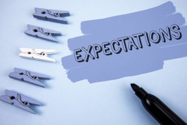 Conceptual hand writing showing Expectations. Business photo text Huge sales in equity market assumptions by an expert analyst written on Painted background wooden Clips and Marker next to it.