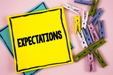 Text sign showing Expectations. Conceptual photo Huge sales in equity market assumptions by an expert analyst written on Sticky Note Paper on plain background Paper Balls and Wooden Clips.
