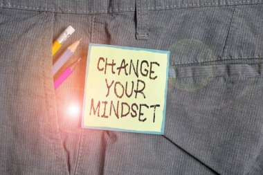 Text sign showing Change Your Mindset. Conceptual photo replace your beliefs way of thinking mental path Writing equipment and green note paper inside pocket of man work trousers.