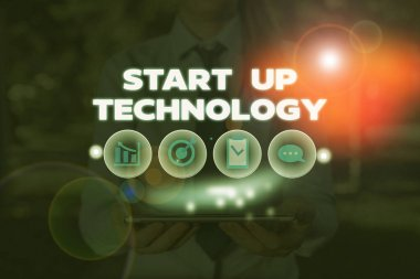 Conceptual hand writing showing Start Up Technology. Business photo showcasing Young Technical Company initially Funded or Financed.