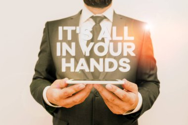 Text sign showing It S All In Your Hands. Conceptual photo we Hold the Rein of our Destiny and Fate Male human wear formal work suit hold smart hi tech smartphone use hands.