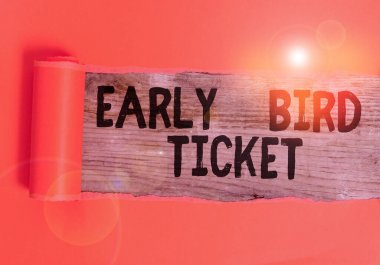 Word writing text Early Bird Ticket. Business photo showcasing Buying a ticket before it go out for sale in regular price Cardboard which is torn in the middle placed above a wooden classic table stock vector