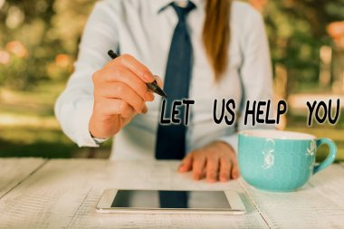 Word writing text Let Us Help You. Business concept for Offering a service to someone to help him in his necessity Business woman sitting by the table with cup of coffee and mobile phone.