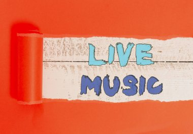 Word writing text Live Music. Business concept for perforanalysisce given by one or more singers or instrumentalists Cardboard which is torn in the middle placed above a wooden classic table.