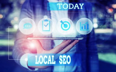 Text sign showing Local Seo. Conceptual photo This is an effective way of marketing your business online Female human wear formal work suit presenting presentation use smart device.