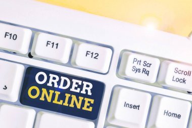 Word writing text Order Online. Business concept for activity of buying products or services over the Internet White pc keyboard with empty note paper above white background key copy space.
