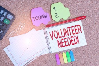Conceptual hand writing showing Volunteer Needed. Business photo text asking demonstrating to work for organization without being paid Desk notebook paper office paperboard study supplies chart.