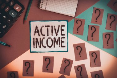 Writing note showing Active Income. Business concept for Royalties Salaries Pensions Financial Investments Tips Mathematics stuff and writing equipment above pastel colours background