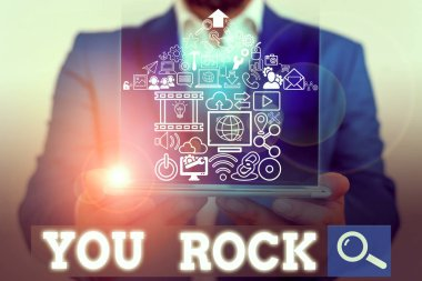 Word writing text You Rock. Business photo showcasing slang phrase of praise or encouragement conveying you are awesome