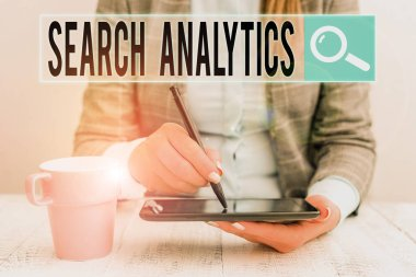 Conceptual hand writing showing Search Analytics. Concept meaning investigate particular interactions among Web searchers Business woman sitting with mobile phone and cup of coffee