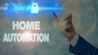Writing note showing Home Automation. Business concept for home solution that enables automating the bulk of electronic