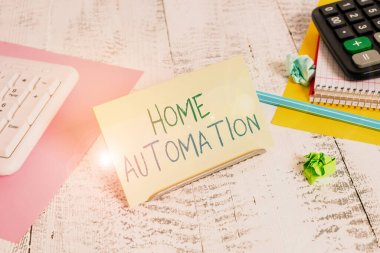 Conceptual hand writing showing Home Automation. Concept meaning home solution that enables automating the bulk of electronic Notepaper on buffer wire in between keyboard and math sheets